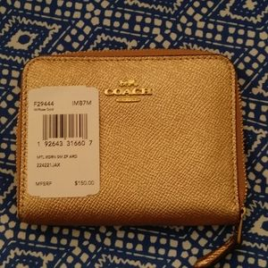 Coach small zip around wallet.